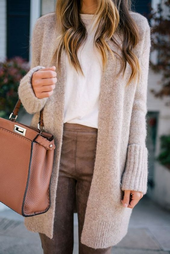 a white tee, brown leather pants, a neutral long cardigan, a rust bag for fall or winter