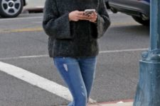 12 blue skinnies, a dark grey sweater and bright printed faux fur loafers