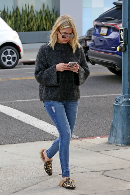 blue skinnies, a dark grey sweater and bright printed faux fur loafers