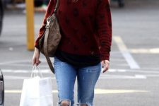 13 a bold burgundy sweater, rippped blue jeans, faux fur loafers and a beanie