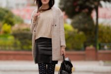 13 a creamy sweater, a black leather mini, an off-white cardigan, printed tights, black shoes and a backpack
