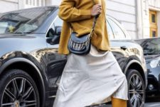 13 a neutral midi skirt, a mustard turtleneck oversized sweater, yellow tall boots and a black bag