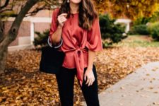 13 a red silk blouse, black pants, a black velvet bucket bag and leopard print shoes