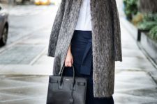13 a white shirt, black culottes, neutral shoes, a grey faux fur coat and a black bag
