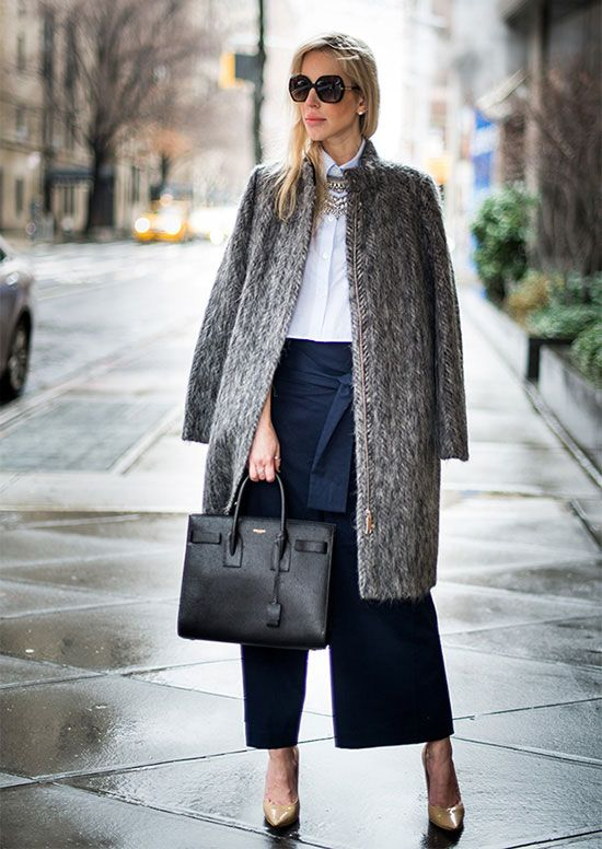 a white shirt, black culottes, neutral shoes, a grey faux fur coat and a black bag