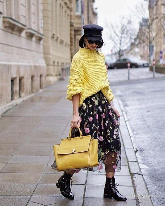 black lacquer boots, a floral A-line midi skirt, a neon yellow oversized sweater and a mathcing bag