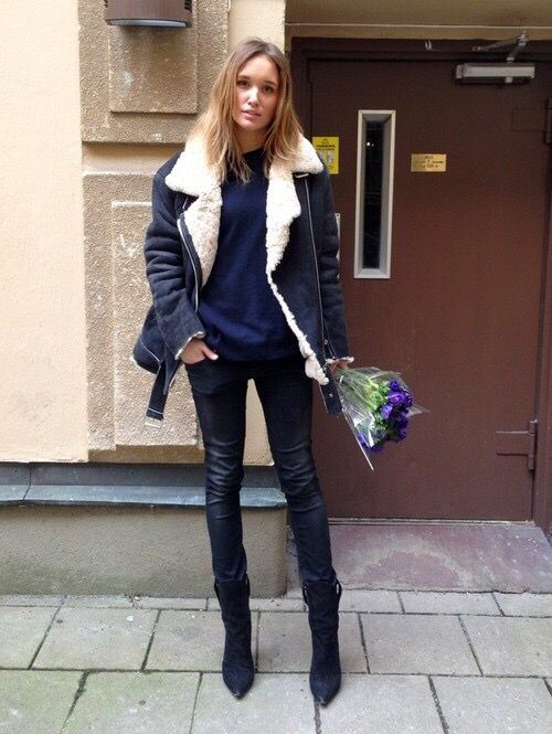 navy skinnies, black booties, a midnight blue sweater, a black shearling coat