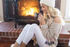 13 white leggings, a neutral one shoulder sweater, moccasins with fur and a knit beanie
