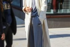 14 a grey tracksuit, white trainers and a long creamy duster coat by Gigi Hadid