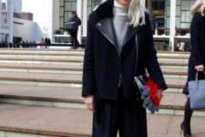14 black culottes and boots, a black coat with leather parts and a grey sweater