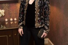 14 black pants, a black velvet top, a heavily embellished blazer and an embellished clutch for a shiny look