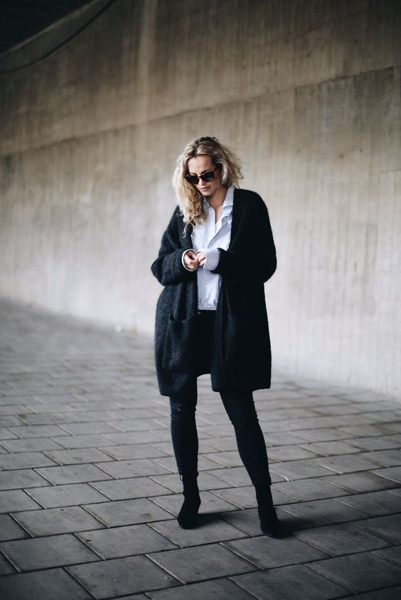 black skinnies, boots, a white shirt and a comfy black cardigan for a great winter look