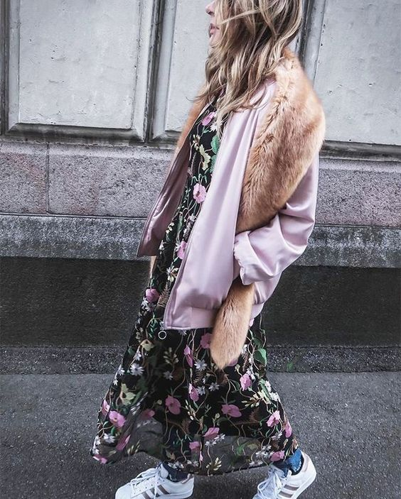 blue denim, an airy moody floral midi dress, white sneakers, a pink bomber jacket and faux fur on top