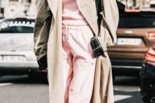 15 a pink tracksuit, a beige trench and white trainers plus a black bag for a comfy winter look