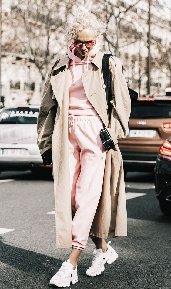 a pink tracksuit, a beige trench and white trainers plus a black bag for a comfy winter look