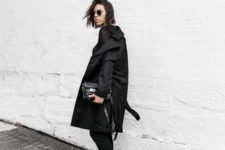 15 a total black look with fur loafers as a trendy touch and centerpiece here