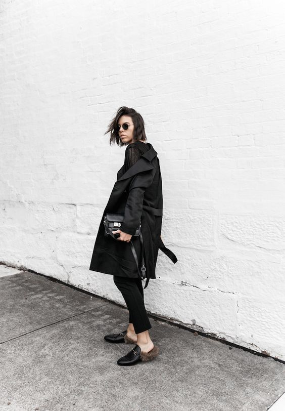 a total black look with fur loafers as a trendy touch and centerpiece here