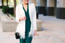 15 an emerald jumpsuit, a creamy long blazer with feathers, black pumps and a black bag