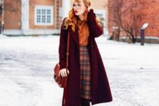15 an orange sweater, a plaid knee skirt, burgundy tights, tall boots and a plum-colored coat and a rust bag