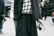15 black culottes, a white shirt, a windowpane sweater, matching socks, polka dot shoes and a black fuzzy coat