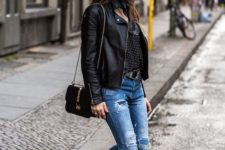 16 a black printed shirt, a black leather jacket, blue ripped jeans and fur loafers