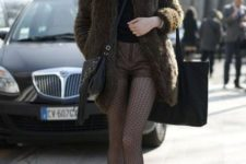 16 a black top, brown leather shorts, printed tights, boots and a faux fur coat