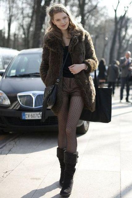 a black top, brown leather shorts, printed tights, boots and a faux fur coat