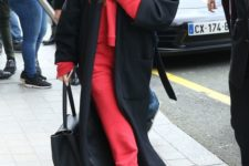 16 a red tracksuit, white sneakers, a black coat and a bag by Selena Gomez