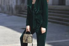 16 a street style outfit with an emerald oversized pantsuit, a black top, white sneakers and an animal print bag