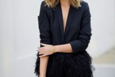16 black velvet pants, a black feather blazer and an embellished clutch for a chic look
