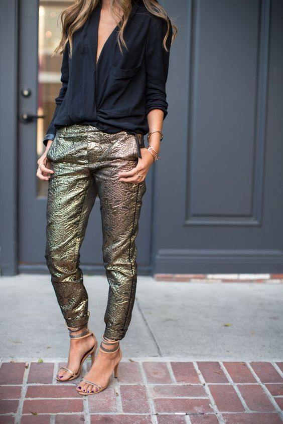 metallic pants, a black shirt with a plunging neckline, metallic shoes for a laconic and simple look