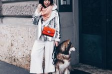 16 white culottes, a pink scarf, a silver shearling coat, a red bag and black pltform boots