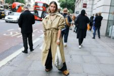 With beige maxi trench coat, wide leg pants and fur shoes
