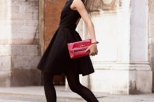 With black dress, black tights and red high heels