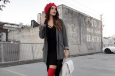 With black dress, gray jacket, white backpack and over the knee boots