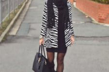 With black dress, high boots, black scarf and tote