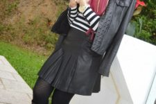 With black hat, black leather jacket, leather skater skirt and boots