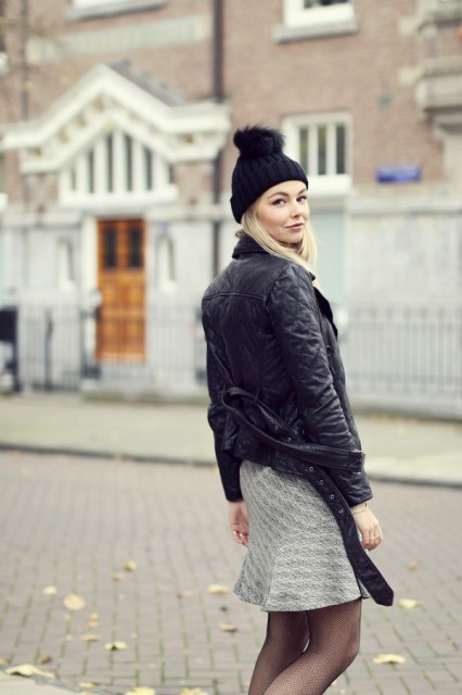 With black jacket and gray skirt