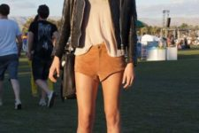 With black jacket, beige top, chain strap bag and ankle boots