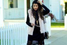 With black lace dress, faux fur vest and black bag