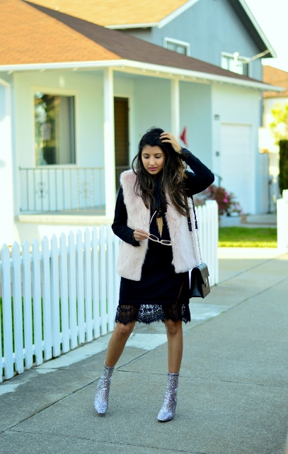 With black lace dress, faux fur vest and black bag