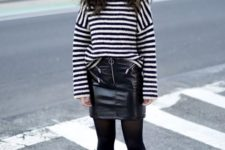 With black leather mini skirt, black tights and ankle boots