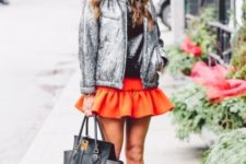 With black leather shirt, orange ruffled skirt, unique boots and black tote