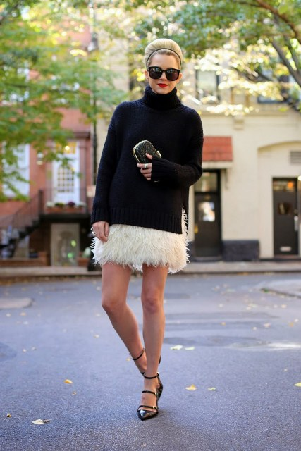 With black loose turtleneck sweater, clutch and black flats