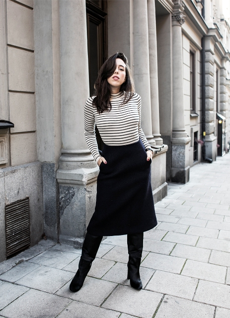 With black midi skirt and high boots
