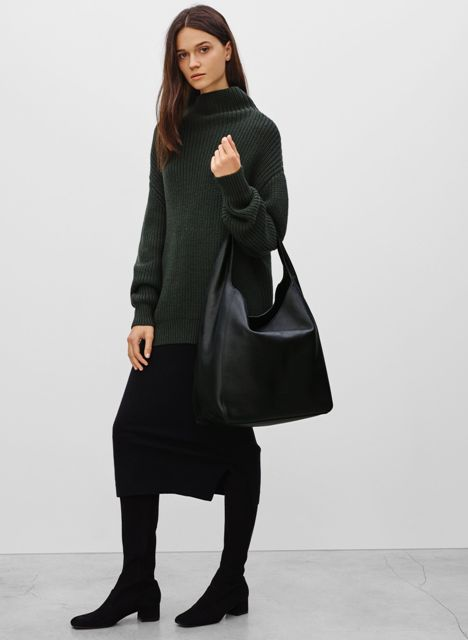 With black midi skirt, dark green long sweater and black boots