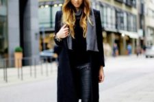 With black shirt, black knee-length coat, leather pants, boots and gray scarf