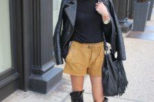 With black shirt, black leather jacket, black leather high boots and fringe bag