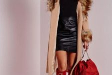 With black shirt, black mini skirt, red suede bag, lace up high boots and hat