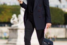 With black shirt, black pants, chain strap bag and navy blue blazer